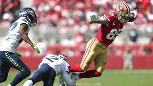 George Kittle (85) runs against D.J. Reed (2) and Marquise Blair.