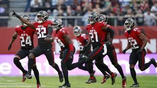 Atlanta Falcons safety Jaylinn Hawkins celebrates making an...