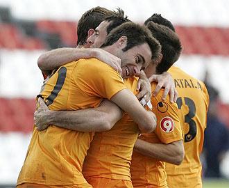 Los jugadores del Alicante celebran un gol ante el Sevilla Atl�tico