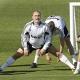 Guti y Cannavaro se entrenan con el resto de la plantilla