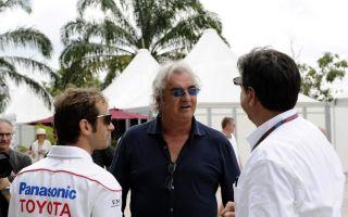 Briatore, junto a Jarno Trulli, de Toyota
