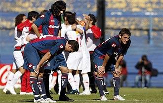 Bergessio, a la derecha, en un partido con San Lorenzo.