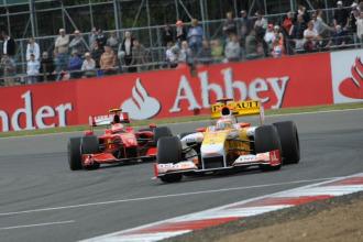 Alonso y Raikkonen, durante un Gran Premio