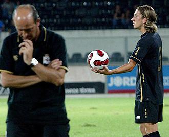 Lotina y Filipe durante un partido