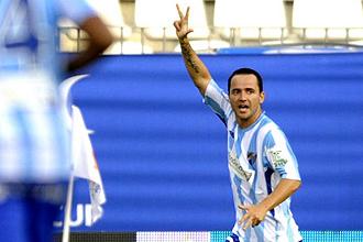 Luque celebra un gol con el Málaga