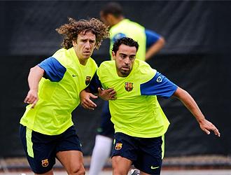 Puyol y Xavi, a tope en un entrenamiento