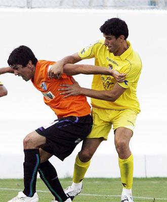 Lance del partido entre el Málaga y el Cádiz
