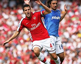Cesc durante un partido con el Arsenal