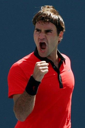 Roger Federer celebra su victoria ante Lleyton Hewitt en el US Open.
