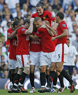 El United celebra un gol ante el Tottenham.
