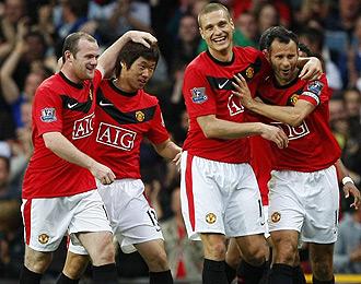 Los jugadores del United celebran un gol en la Premier
