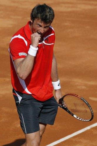 Juan Carlos Ferrero celebra su victoria sobre Dudi Sela en Murcia.