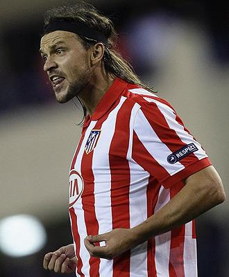 Ujfalusi durante un partido con el Atlético