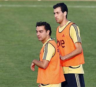 Busquets y Xavi, en un entrenamiento de la selección.
