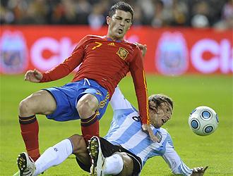 Villa recibe una entrada por detrás de Heinze