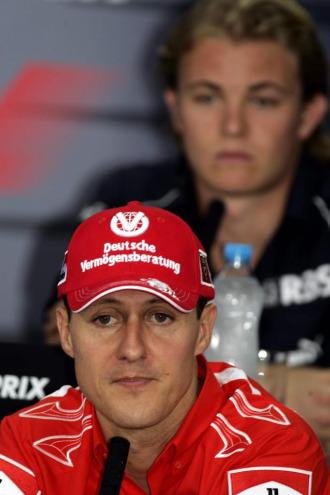 Schumacher y Rosberg, en una rueda de prensa en 2006