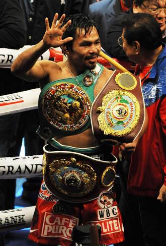 Manny Pacquiao celebra la consecuci�n de su s�ptimo t�tulo mundial.