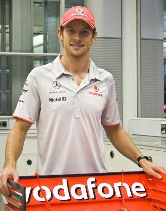 Jenson Button posa por primera vez con el uniforme de McLaren.
