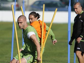 Dani, junto a Sergio Garc�a, durante un entrenamiento del Betis.