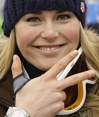 Lindsey Vonn celebrando su triple triunfo