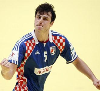 Duvnjak celebra un tanto ante Polonia.