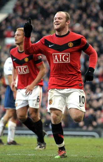 Wayne Rooney celebra un gol ante el Portsmouth.
