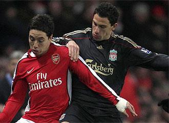 Nasri y Maxi, durante un partido