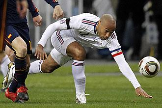 Henry, durante un partido con Francia