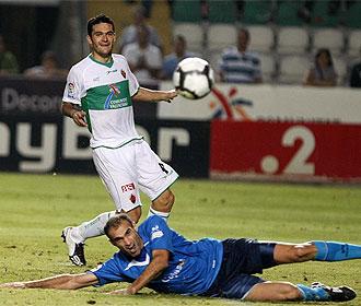 Molina y Mora, en el partido de la primera vuelta.