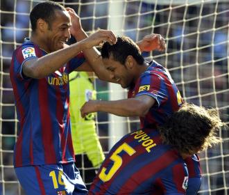 Los jugadores del Barcelona celebran el gol de Jeffren contra el Xerez.