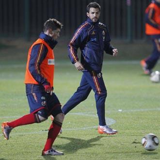 Torres y Cesc en el entrenamiento vespertino