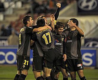 Los jugadores del H�rcules celebran el gol de Cristian en el �ltimo triunfo de los alicantinos fuera de casa: fue en Albacete un lejan�simo 2 de enero
