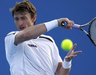 Juan Carlos Ferrero en un lance del partido