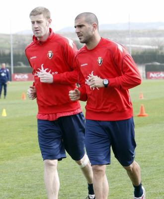Aranda corre junto a Sergio en un entrenamiento.