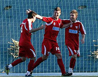 Quini, en el centro, celebrando un gol con el Leganés