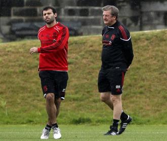 Mascherano junto a Roy Hodgson en un entrenamiento.