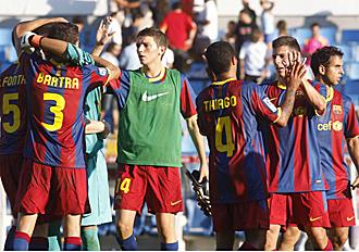 Los jugadores del filial azulgrana celebran su victoria en Balaidos.