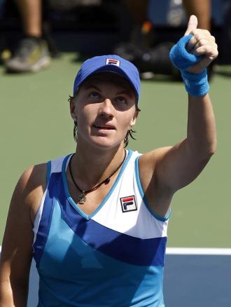 Svetlana Kuznetsova celebra su victoria ante Kimiko Date.