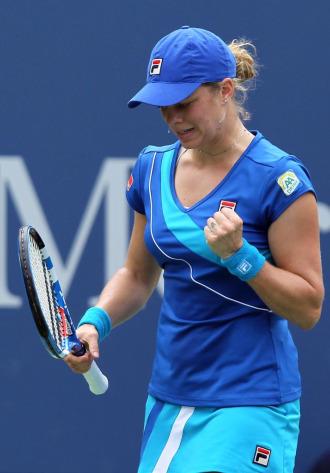 Kim Clijsters celebra un punto en su partido ante Petra Kvitova.