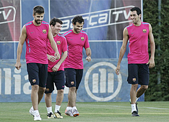 Piqu�, Messi, Mascherano y Busquets durante un entrenamiento.