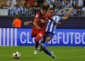 G�mez defiende a Perotti en el M�laga-Sevilla