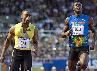 Tyson Gay, con Usain Bolt.