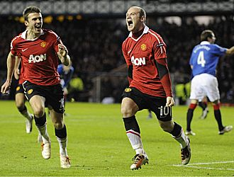 Rooney celebra el gol de penalti que dio el triunfo al United