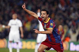 Xavi celebra un gol contra el Madrid