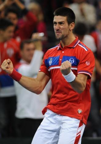 Novak Djokovic celebra su victoria ante G�el Monfils.