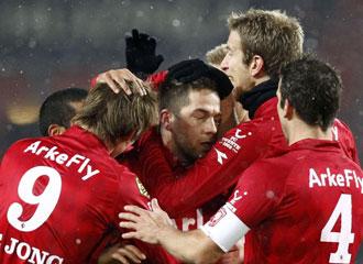 Jugadores del Twente celebran un gol.