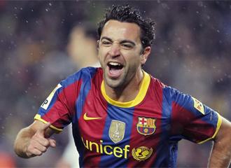 Xavi celebra un gol.