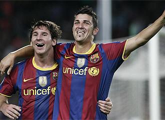 Messi y Villa celebran un gol.