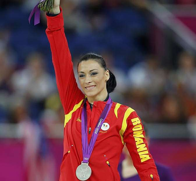 Romanias Catalina Ponor celebrates on the podium after the