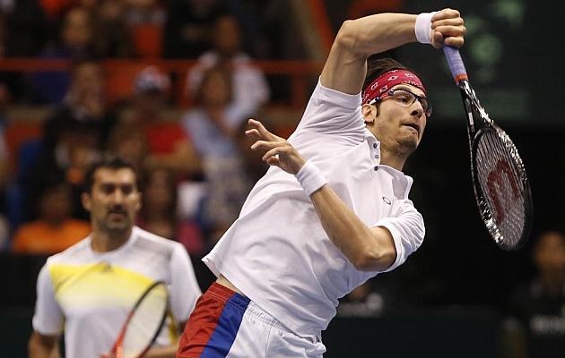 Serbia, Argentina, Rep. Checa y Canad�, con ventaja tras los dobles